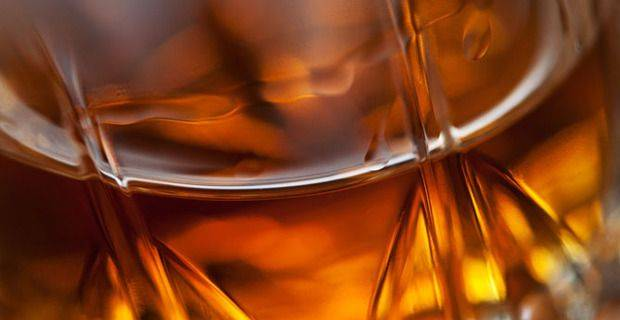 Glass of Malt Whisky in a Crystal Glass Closeup